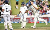New Zealand's Trent Boult celebrates the wicket of India's Prithvi Shaw
