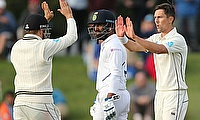 New Zealand's Trent Boult and Tom Latham celebrate after the wicket of India's Umesh Yadav