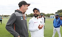 New Zealand's Tim Southee and India's Virat Kohli after the match