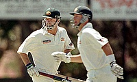 Australian captain Steve Waugh (L) and his brother Mark cross over during their 254 runs partnership