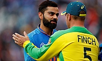 Virat Kohli and Australia's Aaron Finch shake hands at the end