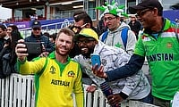 Australia's David Warner poses for a photo with Pakistan fans after the match