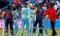 England's Eoin Morgan shakes hands with India's MS Dhoni after the match