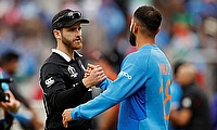 New Zealand's Kane Williamson shakes hands with India's Virat Kohli after the match