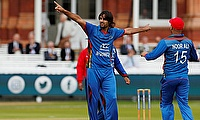 Afghanistan's Shapoor Zadran celebrates a wicket
