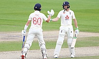 England's Jos Buttler and Ollie Pope