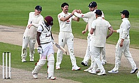 England's James Anderson celebrates the wicket of West Indies' Sharmarh Brooks with teammates