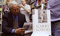 Sir Garry Sobers signs copies of his autobiography