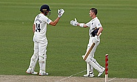 Middlesex's Nick Gubbins celebrates his 100 with Martin Andersson