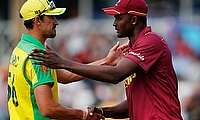 Australia's Mitchell Starc shakes hands with West Indies' Jason Holder