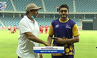 Hassan Khalid receives the player of the match award from UAE Director of Cricket Robin Singh