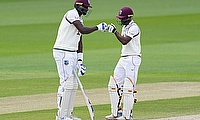 West Indies' Jason Holder touches fists with Sharmarh Brooks
