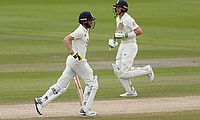 England's Chris Woakes and Jos Buttler in action