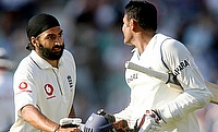 England's Monty Panesar congratulates India's Anil Kumble on his maiden test century