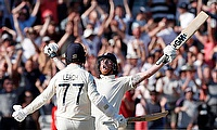England's Ben Stokes and Jack Leech celebrate winning the test