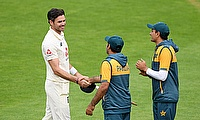 England's James Anderson shakes hands with Pakistan players at the end of play