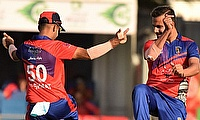 Dawlat Zadran celebrates the fall of a wicket in style