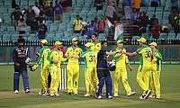 India's Jasprit Bumrah and Navdeep Saini with Australia players after the match