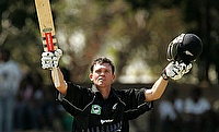 New Zealand batsman Lou Vincent celebrates his century against Zimbabwe at the Queens Sports Club in Bulawayo, Zimbabwe in 2005