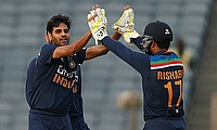 India's Bhuvneshwar Kumar celebrates taking the wicket of England's Jonny Bairstow with Rishabh Pant