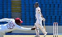 Nkrumah Bonner takes a superb catch to dismiss Dimuth Karunaratne