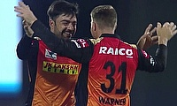 Rashid Khan and David Warner