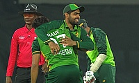 Rauf and Azam celebrate a wicket