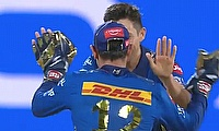 Trent Boult and Quinton de Kock celebrate