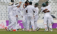 Bangladesh's Mehedi Hasan Miraz is congratulated by his teammates