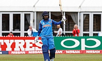 Mithali Raj acknowledges the crowd after scoring 100 runs