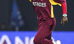 Kemar Roach celebrates a wicket for the West Indies