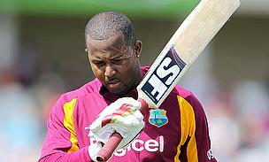 Dwayne Smith raises his bat