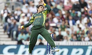 Ajmal delivers the ball