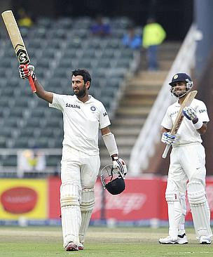 Cheteshwar Pujara celebrates his century