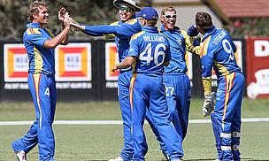 Namibia players celebrate a wicket