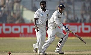 Muralitharan and Sehwag during a test match between Sri Lanka and India