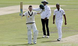 Michael Clarke raises his bat