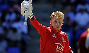Joe Root raises his bat
