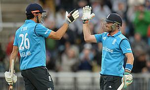 Alastair Cook (left) and Ian Bell celebrate England's 10-wicket win over Sri Lanka