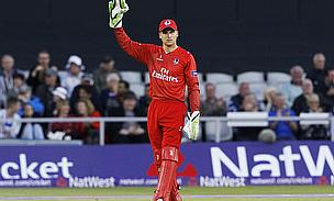 Jos Buttler gestures to a team-mate