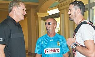 Tom Moody, CPL International Director of Cricket, and Matthew Maynard, manager of the St. Lucia Zouks greet Kevin Pietersen on his arrival in St Kitts