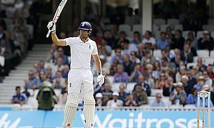 Alastair Cook celebrates his half-century