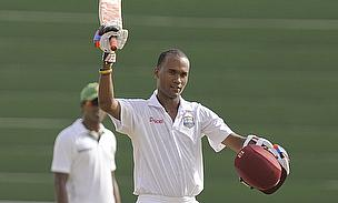 Kraigg Brathwaite raises his bat to celebrate reaching his Test century against Bangladesh in Saint Vincent