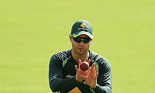 Michael Clarke takes a catch in training