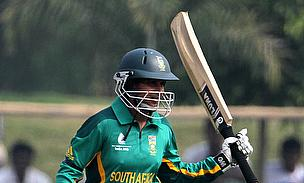 Trisha Chetty raises her bat