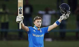 Joe Root celebrates reaching his match-winning century in Pallekele