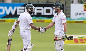 Hashim Amla (left) and AB de Villiers batted for all but 15.5 overs of the opening day