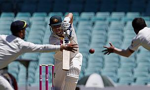 Shane Watson's shot eludes two Indian fielders - the story of the opening day at the SCG