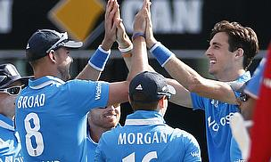 Steven Finn (right) celebrates one of his five wickets