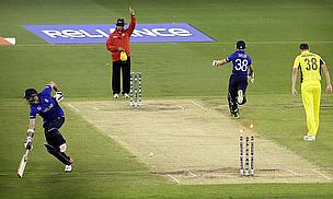 The moment in question as James Taylor (right) is given out while James Anderson fails to make his ground